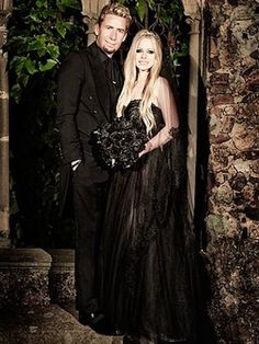 Punk rocker, Avril Lavigne, wore a black wedding gown for her nuptials when she married fiancé Chad Kroeger on July 1, 2013. She wore a bejeweled flower headpiece in her long blonde hair to complement her strapless black Monique Lhullier gown and black veil. They had a elaborate wedding ceremony at the Chateau La Napoule in Mandelieu, France, and treated their guests to an impressive fireworks display on the Mediterranean. The honeymoon was in Portofino, Italy.