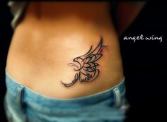 totem type abstract angel wing tattoo on the hip