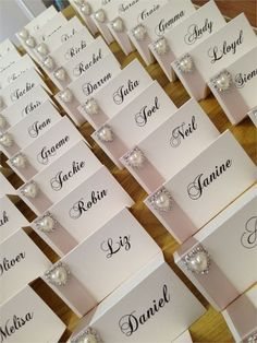 Name cards with champagne satin ribbon and pearl diamante heart embellishment.