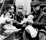 Young Vito Corleone with his wife Carmela and their children
