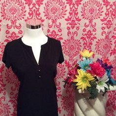 Black Shirt Soft black shirt with three small silver buttons in the front. Tops Blouses