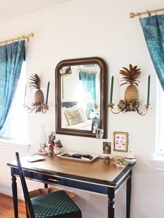 especially the pineapple sconces (valspar metallic gold painted curtain hardware)