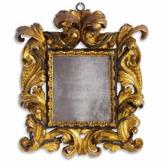 An Italian baroque giltwood and parcel-ebonized frame probably Rome, 17th century, now fitted as a mirror.