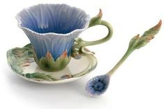 Pretty cup, blue shaped like a flower with matching spoon.