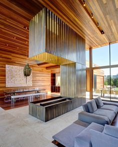 The wood warms up the expansive s pace.  Bates Masi Architects LLC