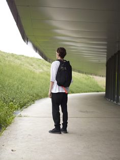 """This architectural form creates a strong silhouette and is highly practical. The asymmetrical shape features two main compartments, the front section expands according to your carrying needs. In the rear compartment, a padded pocket provides safe storage for laptops of up to 15"""". Webbing straps in khaki and neon orange bring a touch of colour to this ISAR backpack, made from Ecoya fabric. Safe Storage, Herschel Heritage Backpack, Laptops, Carry On, Maine, Smooth, Bring It On, Strong, Neon"""
