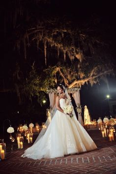 The dress, the veil, the bouquet. Everything is breathtaking. We love this photo and the candles add a special touch