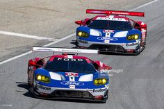 The #67 Ford GT of Ryan Briscoe and Richard Westbrook leads the #66 Ford GT of Dirk Muller and Joey Hand during the IMSA WeatherTech Series race at Mazda Raceway Laguna Seca on May 1, 2016 in Monterey, California.