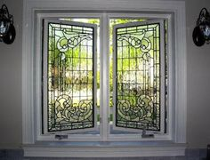 Casement Window: A window that swings inward or outward like a door. May be grouped in bands.