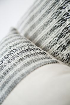 Pillows with hand woven and brocaded cotton Mitla textile application (detail)