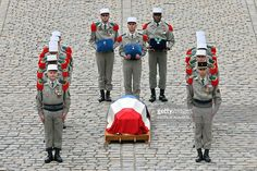 French Foreign Legion members carry the coffin of Lazare Ponticelli, the last of the French World War 1 veterans, during his state funeral ceremony in the courtyard of the Invalides in Paris on March 17, 2008. The ceremony for Ponticelli, who died on March 12, 2008 aged 110, was attended by the majority of the French government members and marks the commemoration for the 8.5 million French soldiers who died in battle during the 1914 -1918 war.