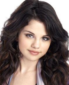 Selena Gomez wearing silver glass heart earrings by Jenny Dayco.