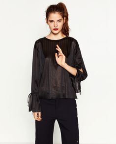 Image 2 of BLOUSE WITH CORD ON SLEEVE from Zara