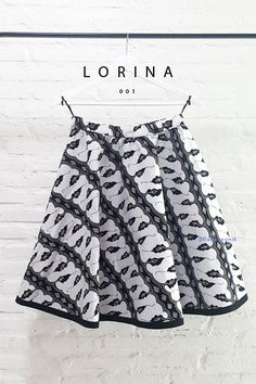 Lorina 001 IDR 475.000 Elastic Contemporary Batik Parang Flare Skirt  Length of Skirt : approx. 60 cm  Material used : Contemporary Batik Parang Design, Cotton. Floral Embroidery.