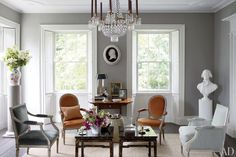 An Elegant Federal Style Country House, in Claverack, New York. Living room with a bust of Thomas Jefferson and 19th-century bas-relief of George Washington. Decorators Bruce Shostak and Craig Fitt