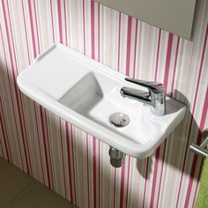 Stock photo of the sink we used. Found it at Wayfair - Universal Oxigen Wall Hung Ceramic Bathroom Sink. Tiny sink for the tiny bathroom under the stairs.