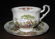 """VINTAGE Royal Crest Fine Bone China England Tea Cup Saucer Gold Trimmed Courting - CAD $31.32. Wonderful Tea Cup and Saucer Set An old fashioned Courting scene. Royal Crest Fine Bone China - England The Cup measures approximately 3 1/2"""" in Diameter and stands 2 5/8"""" tall. The Saucer measures approximately 5 1/2"""" in Diameter. No chips or cracks. Happy Bidding or Just Browsing! We will gladly combine shipping- Email when you have finished shopping and we will send ..."""