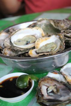"""2 bucket full of Oysters $2. ROXAS CITY """"Seafood Capital of the Philippines"""", the Beautiful Island with charcoal colored sand and white sand beaches around."""