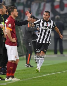 Carlos Tevez of Juventus FC celebrates after scoring the opening goal during the Serie A match between AS Roma and Juventus FC at Stadio Olimpico on March 2, 2015 in Rome, Italy.