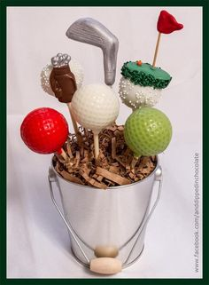 Golf centerpiece ideas   Either make the cake pops or--- Plastic golf balls and spray paint and decorate them  Fun idea!! - Alice