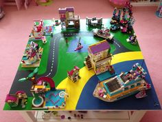 Lego Friends Heartlake City scene table top made from hardboard, slots over coffee table.  Used enamel paint from art shop.