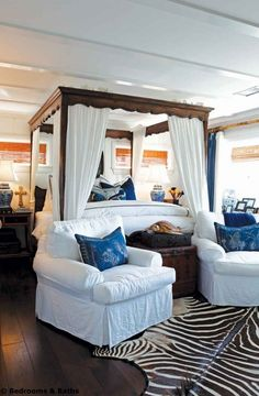 Nautical Bedroom Theme With Round Bookshelf Storage System And White Wall Panel And Stripe Vertical Red Curtain And High Back Chair Furniture And Artistic Iron Lamp And Wooden Bed Frame Bedroom Nautical Bedroom Themes With Different Ocean Furniture Accessories coastal bedding