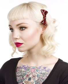 SOURPUSS LEOPARD GLITTER HAIR BOW RED    Give your fringe a little glitter! This set includes one pair of glittery, red, leopard print vinyl bows. Each is securely mounted on a smooth alligator clip.    $6.00