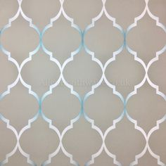 An elegant shimmering metallic silver and teal trellis design on a grey background. It's paste the wall too, making it quick and easy to hang.