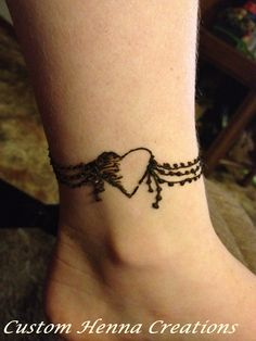 Henna on ankle, mehndi, heart wrap-around design, on child's ankle. Henna done by Custom Henna Creations - now known as Marigold Mehndi.