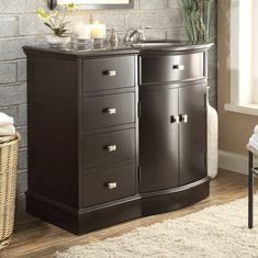 Aldous BrownT he modern design Adlous vanity featuring a black granite top and sturdy body, this sink vanity is the ideal choice for those who seek a functional and polished model. Its non-intrusive and sleek body provides a surprisingly large a 40 Inch Bathroom Vanity, Discount Bathroom Vanities, Single Sink Vanity, Cheap Bathrooms, Vanity Sink, Bathroom Sets, Granite Tops, Black Granite, How To Clean Stone