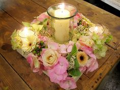 Flowers & candles in a square wooden tray.