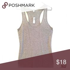 Gray Racerback w/ Metallic Stud Detail (Old Navy) Need the PERFECT top for your next girls night out? Look no further than this FABULOUS little number from Old Navy! This BRAND-NEW gray racerback is adorned with metallic studs to give you the PERFECT amount of SPARKLE and SHINE!  Style Note: The length of this long tank makes it GREAT for layering! Throw on a cute jacket over the top, and get ready for the compliments to come your way!  Care instructions: Machine wash cold, gentle cycle…