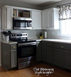 Transformation--orange oak cabinets:   uppers painted white, lowers painted gray, lighter gray walls & black & white accents.  Nice.  Walls:  BM Gray Owl, Lower Cabinets:  BM Desert Twilight, Upper Cabinets:  High Hiding White in ACE Cabinet & Trim paint.