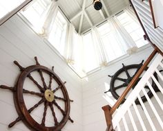 Steering towards Nautical Nostalgia -A Home Inspired by Shipwheels and the Movie Summer of 42: http://www.completely-coastal.com/2013/10/nautical-home-shipwheels-Summer-of-42.html