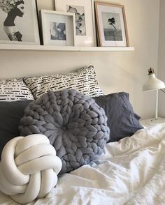 Perfect master bedroom with texture. Texture adds enormous personality to an otherwise neutral bedroom. Round button cushion in 100% Australian Merino Wool - grey and white bedroom space. See this Instagram photo by @closely.knit • 204 likes