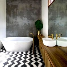 Modern Bathroom Design. Gold and Gray with black and white floor. Porcelain tile and Porcelain Tub.