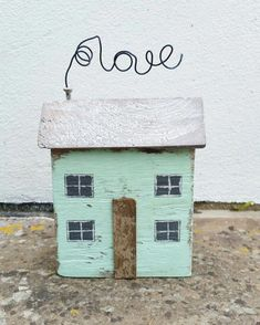 """Driftwood cottage 'Beach craft' Very cute """"Little House"""" bit fiddly doing the wire bending but very cute. I like the simple house style with just that touch of distressing not to much to detract from the main element very good ; Wooden Art, Wooden Crafts, Pallet Crafts, Small Wooden House, Wooden Cottage, Beach Crafts, Home Crafts, Beach Wood, Driftwood Crafts"""