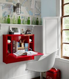 In this North Carolina home, a bedroom's office area gets pops of color from vintage soda bottles and a fire engine red wall-mounted desk. The Eames-style chair was a garage sale find.