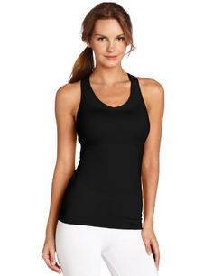 Russell Athletic Women's Mid-Support Racerback Tank Top Russell Athletic. $15.98. Machine Wash. Logo on outside back neck. Two-needle hem bottom. Dri-power moisture wicking fabric. 87% Polyester/13% Spandex. Built0in mid-support bra with removable cups. Lower back zip pocket