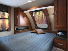 Gallery - Lance 2295 Travel Trailer - Standard exterior kitchen and available interior fireplace set the 2295 apart. Travel Trailer Floor Plans, Accordion Doors, Fireplace Set, Overhead Storage, Shower Rod, Diy Camper, Extra Rooms, Large Bedroom, Travel Trailers