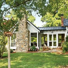 Perfect screened porch with fireplace . . . LOVE this!