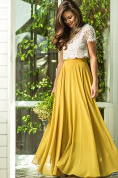 This maxi skirt is all you could have asked for and more! With flowy layers, a flattering silhouette and gorgeous yellow-chartreuse color, this skirt is bright essential for your wardrobe.
