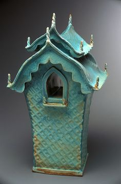 Spirit Houses, lovely sculpture piece but you don't want to bring it inside.