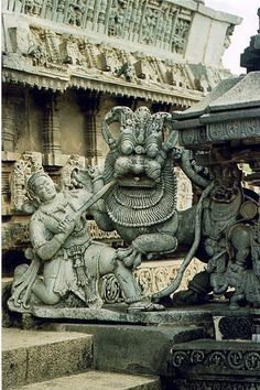 Its the Hoysala dynasty ! The king in the emblem is Sala ! Hoy in old kannada meant to strike hence the name Hoysala ! And it was King Vishnuvardhana who popularised the folklore.   The picture above is the symbol of the Hoysalas at Belur in Karnataka !  And yes Halebidu 16 kms from Beluru was the regal capital of Hoyasala dynasty !