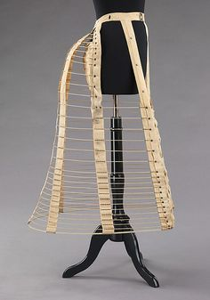 8. The bustles war small down or cotton-filled pads that tied on around the waist at the back. Bustles of this time could also be made from wires or metal cages, like the one depicted here that was created in 1885. Bustles were meant to hold out skirts in the back and create back fullness.