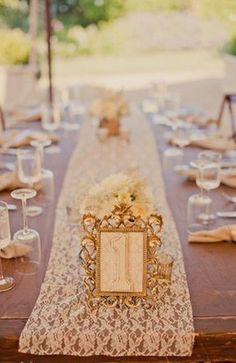 gold framed table number + lace table runner.