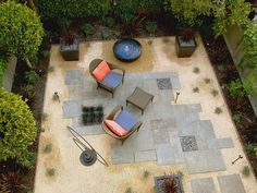 -For side entrance, pebbles, big stepping stones and big black pots. Sitting area. Next to BBQ.
