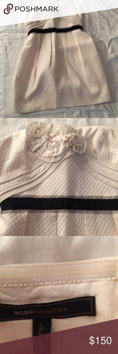 BCBG strapless dress BCBG strapless dress with black strip waste and flower detail. Zipper back. Worn once. BCBG Dresses Strapless