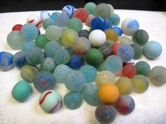 sea glass marbles....marbles lost at sea that wash ashore...do I put this under marbles or sea glass? Both!