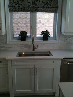 Large kitchen sink with no divider.